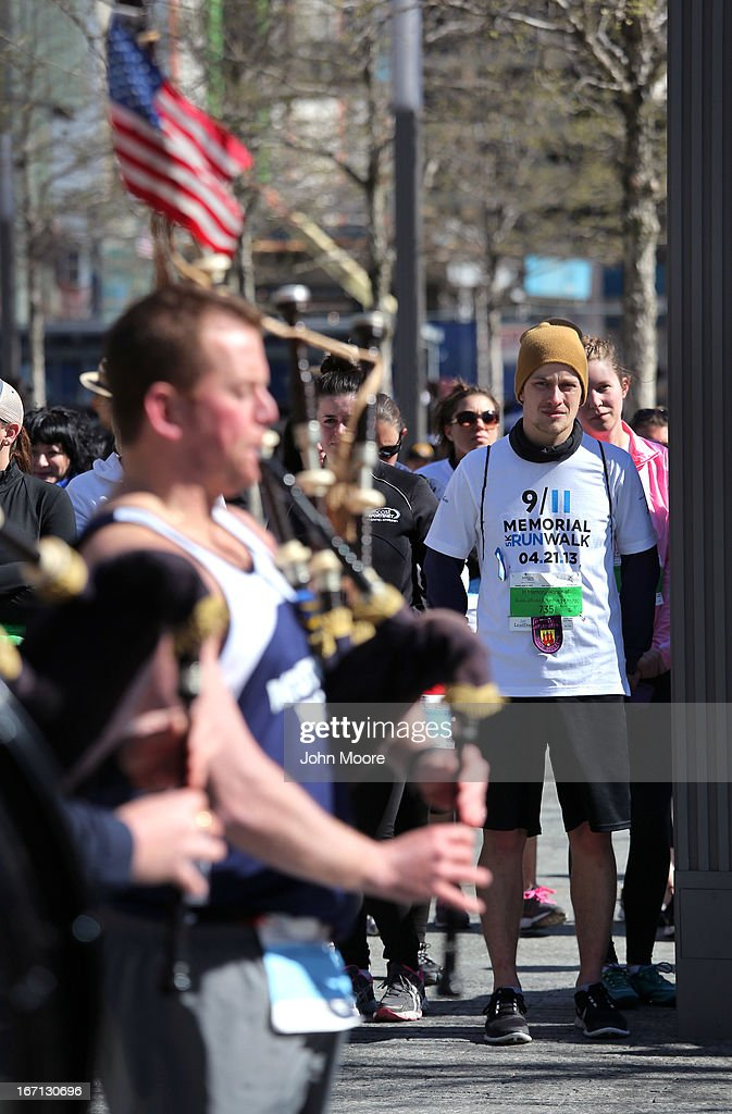 Runners watch a police bagpipe band play following the 9/11 Memorial 5K Run/Walk on April 21, 2013 in New York City. Security was tight for the race, as has been the case in large scale events around the country since the Boston Marathon bombings. April 21 marks the anniversary that President Barack Obama signed into law legislation making 9/11 a day of service and volunteerism in memory of the victims of the 2001 attacks.