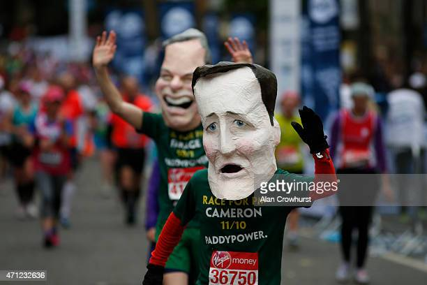 Runners wear David Cameron and Nigel Farge heads during the Virgin Money London Marathon on April 26 2015 in London England