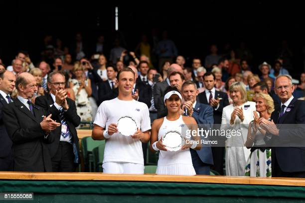 Runnersup Heather Watson of Great Britain and Henri Kontinen of Finland pose with their trophies after the Mixed Doubles final match against Jamie...