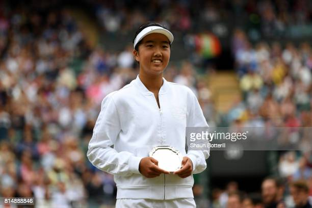 Runnerup Ann Li of the United States poses with her trophy after the Girl's Singles final match against Claire Liu of the United States on day twelve...