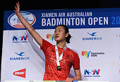 Runnerup China's Sun Yu gestures to spectators while on the podium her defeat by India's Saina Nehwal in their women's singles final at the...