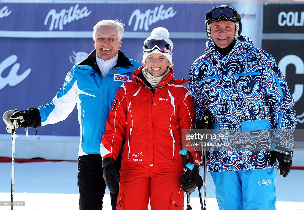 1966 runner-up giant slalom world champion France's Georges Mauduit (L), 2004 snowboarding world champion France's Julie Pomagalski (C) and former pole vaulting world champion and IOC member Ukraine's Sergei Bubka (R) pose for photo during the FIS World Cup Alpine Women's Downhill on February 23, 2013, in Meribel, French Alps. AFP PHOTO / Jean Pierre Clatot