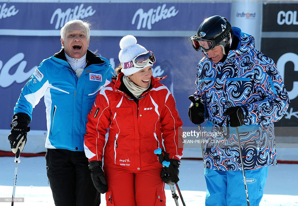 1966 runner-up giant slalom world champion France's Georges Mauduit (L), 2004 snowboarding world champion France's Julie Pomagalski (C) and former pole vaulting world champion and IOC member Ukraine's Sergei Bubka (R) laugh as they pose for photo during the FIS World Cup Alpine Women's Downhill on February 23, 2013, in Meribel, French Alps. AFP PHOTO / Jean Pierre Clatot