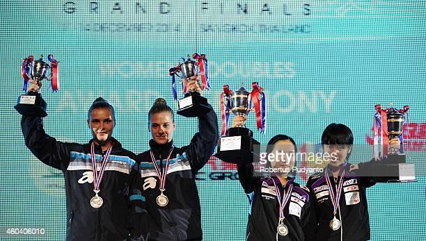 Runnerup Grybowska Katarzyna Partyka Natalia of Polandia and winner Mima Ito Miu Hirano of Japan pose with the trophy during the Women's double...