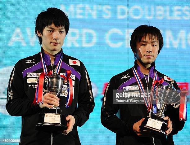 Runnerup Kenta Matsudaira and Koki Niwa of Japan pose with the trophy during the Men's double awarding ceremony of the 2014 ITTF World Tour Grand...