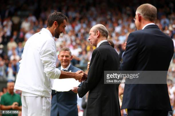 Runnerup Marin Cilic of Croatia is presented with his trophy by the Duke of Kent after the Gentlemen's Singles final against Roger Federer of...