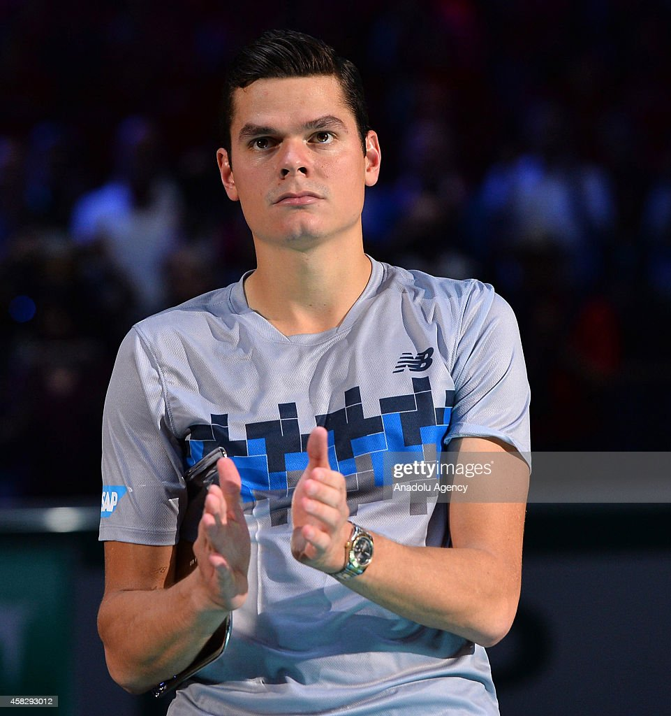 Runner-up Milos Raonic of Canada poses celebrates winner Novak Djokovic of Serbia after the Final match during the 7th of the BNP Paribas Masters held at the at Palais Omnisports de Bercy in Paris, France, on November 2, 2014.