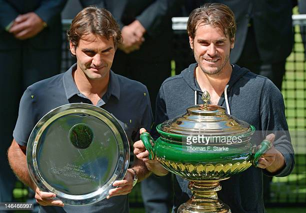 Runnerup Roger Federer of Switzerland and winner Tommy Haas of Germany pose for photographers after the final match during day seven of the Gerry...