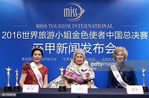 Runnerup Zhen Ping champion Han Bin and third winner Wang Nianwen of 'Miss Tourism International ' attend the press conference after Miss Tourism...