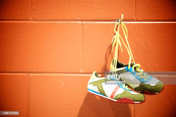 runnig shoes hanging on a hook
