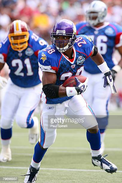 Running Adrian Peterson of the NFC's Minnesota Vikings runs the ball against the AFC during the 2008 NFL Pro Bowl at Aloha Stadium on February 10...