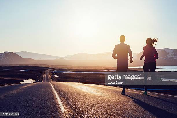 Running along road at sunrise in Iceland