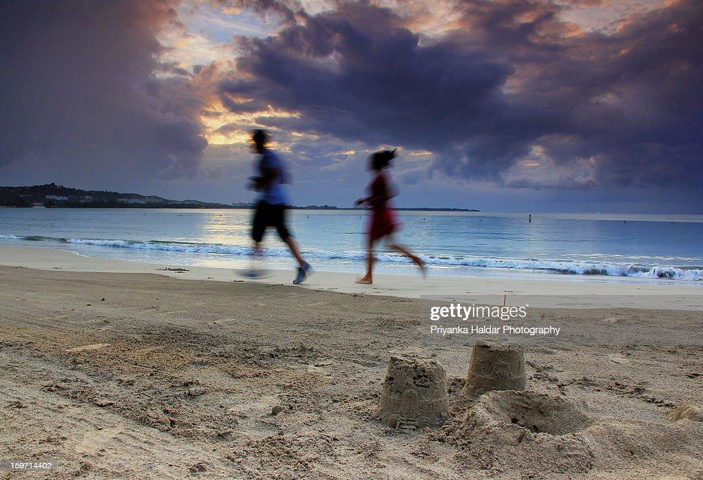 Running away from the sunset gloom.. : Stock Photo
