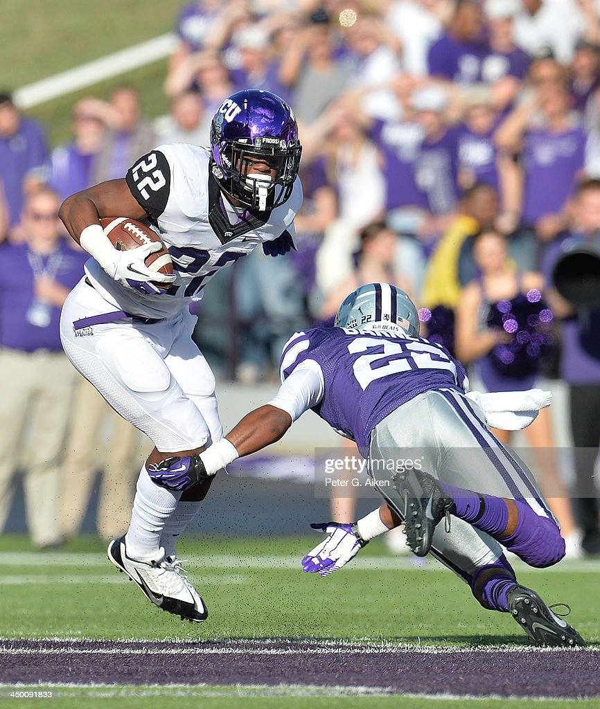 Running back Aaron Green #22 of the TCU Horned Frogs cuts around defender Dante Barnett #22 of the Kansas State Wildcats during the first half on November 16, 2013 at Bill Snyder Family Stadium in Manhattan, Kansas.