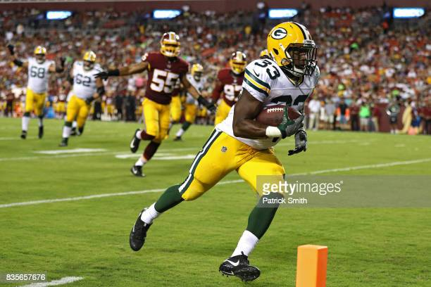Running back Aaron Jones of the Green Bay Packers scores a touchdown against the Washington Redskins in the first half during a preseason game at...