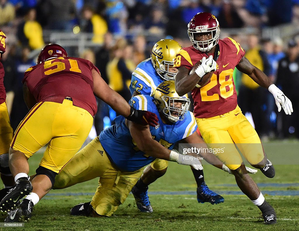 Running back Aca'Cedric Ware #28 of the USC Trojans carries the ball against the UCLA Bruins at Rose Bowl on November 19, 2016 in Pasadena, California.