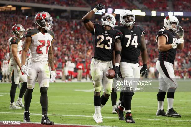 Running back Adrian Peterson of the Arizona Cardinals celebrates alongside DJ Humphries after scoring on a one yard rushing touchdown against the...