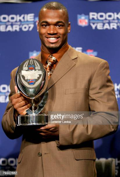 Running back Adrian Peterson of the Minnesota Vikings accepts the 2007 Diet Pepsi NFL Rookie of the Year Award at a news conference prior to Super...