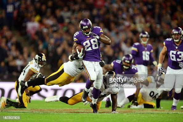 running back Adrian Peterson of the Minnesota Vikings beats outside linebacker LaMarr Woodley of the Pittsburgh Steelers and inside linebacker...