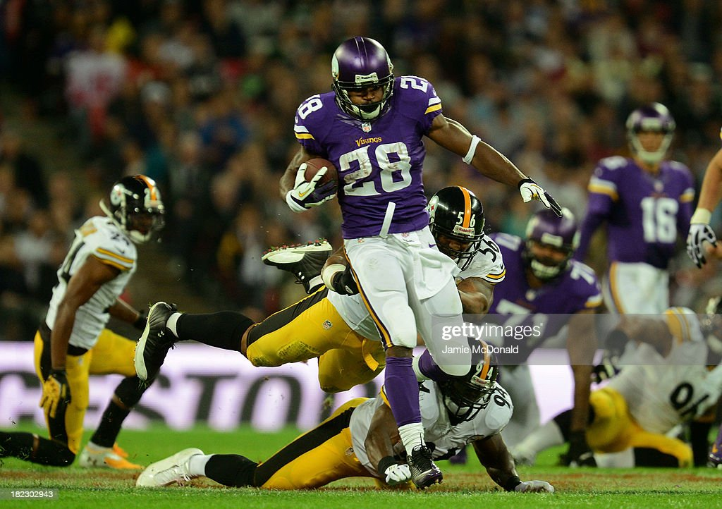 running back <a gi-track='captionPersonalityLinkClicked' href=/galleries/search?phrase=Adrian+Peterson+-+American+Football+Player+-+Minnesota+Vikings&family=editorial&specificpeople=210807 ng-click='$event.stopPropagation()'>Adrian Peterson</a> #28 of the Minnesota Vikings beats outside linebacker <a gi-track='captionPersonalityLinkClicked' href=/galleries/search?phrase=LaMarr+Woodley&family=editorial&specificpeople=2106574 ng-click='$event.stopPropagation()'>LaMarr Woodley</a> #56 of the Pittsburgh Steelers and inside linebacker <a gi-track='captionPersonalityLinkClicked' href=/galleries/search?phrase=Lawrence+Timmons&family=editorial&specificpeople=2138080 ng-click='$event.stopPropagation()'>Lawrence Timmons</a> #94 of the Pittsburgh Steelers to score a touchdown during the NFL International Series game between Pittsburgh Steelers and Minnesota Vikings at Wembley Stadium on September 29, 2013 in London, England.