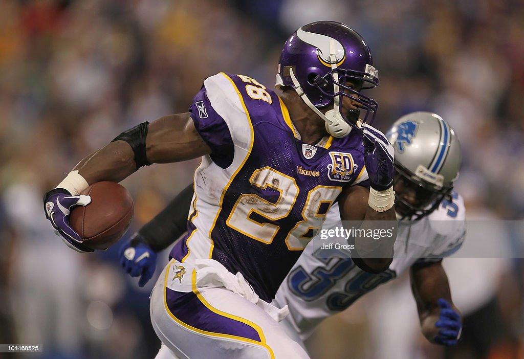 Running back Adrian Peterson #28 of the Minnesota Vikings carries the ball around C.C. Brown #39 of the Detroit Lions for a touchdown during the second half at Hubert H. Humphrey Metrodome on September 26, 2010 in Minneapolis, Minnesota. The Vikings defeated 24-10.