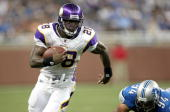 Running back Adrian Peterson of the Minnesota Vikings carries the ball against the Detroit Lions at Ford Field on September 20 2009 in Detroit...