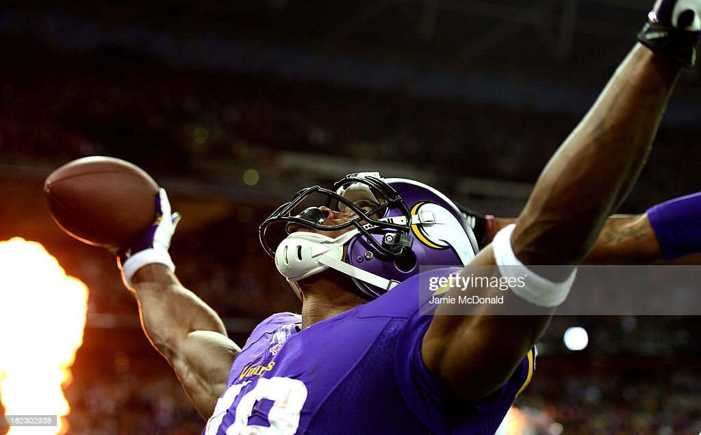 Running back <a gi-track='captionPersonalityLinkClicked' href=/galleries/search?phrase=Adrian+Peterson+-+American+Football+Player+-+Minnesota+Vikings&family=editorial&specificpeople=210807 ng-click='$event.stopPropagation()'>Adrian Peterson</a> #28 of the Minnesota Vikings celebrates as he scores a touchdown during the NFL International Series game between Pittsburgh Steelers and Minnesota Vikings at Wembley Stadium on September 29, 2013 in London, England.
