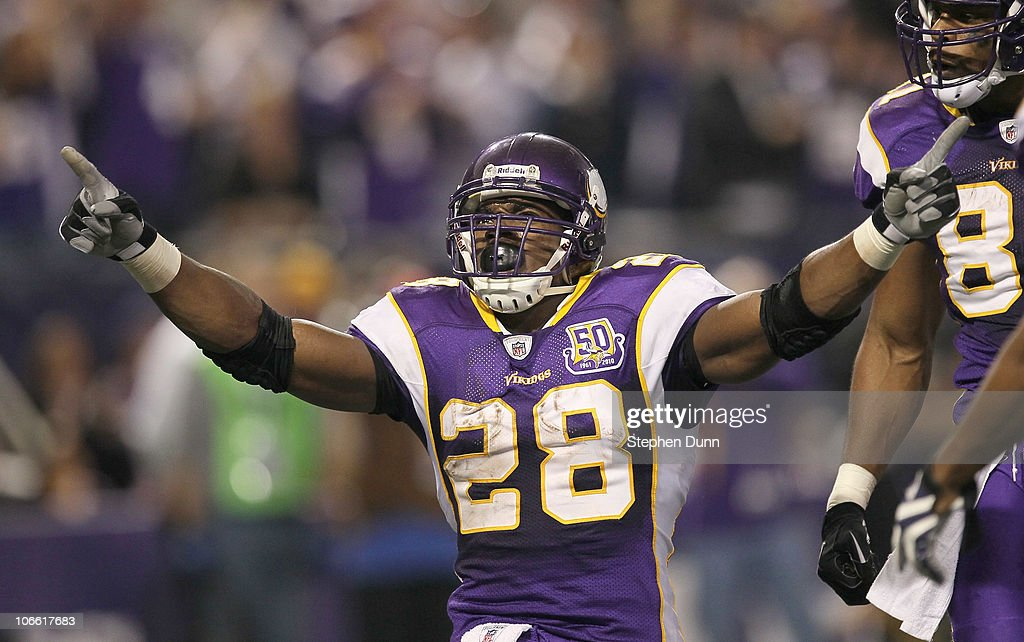 Running back <a gi-track='captionPersonalityLinkClicked' href=/galleries/search?phrase=Adrian+Peterson+-+American+Football+Player+-+Minnesota+Vikings&family=editorial&specificpeople=210807 ng-click='$event.stopPropagation()'>Adrian Peterson</a> #28 of the Minnesota Vikings celebrates after his four yard touchdown run brought the Vikings within a touchdown of the Arizona Cardinals in the fourth quarter at Hubert H. Humphrey Metrodome on November 7, 2010 in Minneapolis, Minnesota. The Vikings won 27-24 in overtime.