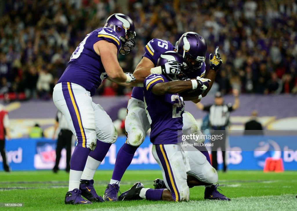 Running back <a gi-track='captionPersonalityLinkClicked' href=/galleries/search?phrase=Adrian+Peterson+-+American+Football+Player+-+Minnesota+Vikings&family=editorial&specificpeople=210807 ng-click='$event.stopPropagation()'>Adrian Peterson</a> #28 of the Minnesota Vikings celebrates with team mates as he scores a touchdown during the NFL International Series game between Pittsburgh Steelers and Minnesota Vikings at Wembley Stadium on September 29, 2013 in London, England.