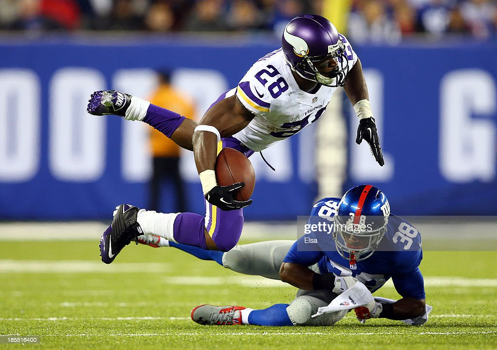 Running back <a gi-track='captionPersonalityLinkClicked' href=/galleries/search?phrase=Adrian+Peterson+-+American+Football+Player+-+Minnesota+Vikings&family=editorial&specificpeople=210807 ng-click='$event.stopPropagation()'>Adrian Peterson</a> #28 of the Minnesota Vikings is tackled by cornerback <a gi-track='captionPersonalityLinkClicked' href=/galleries/search?phrase=Trumaine+McBride&family=editorial&specificpeople=3972074 ng-click='$event.stopPropagation()'>Trumaine McBride</a> #38 of the New York Giants during a game at MetLife Stadium on October 21, 2013 in East Rutherford, New Jersey.
