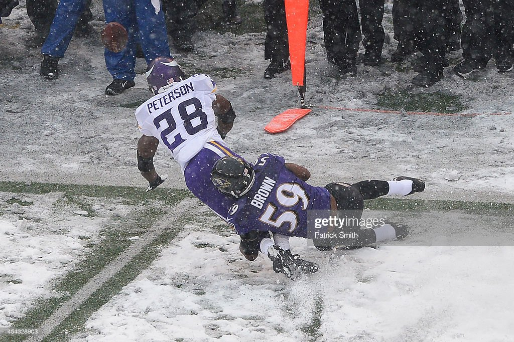Running back <a gi-track='captionPersonalityLinkClicked' href=/galleries/search?phrase=Adrian+Peterson+-+American+Football+Player+-+Minnesota+Vikings&family=editorial&specificpeople=210807 ng-click='$event.stopPropagation()'>Adrian Peterson</a> #28 of the Minnesota Vikings is tackled by inside linebacker Arthur Brown #59 of the Baltimore Ravens in the first half at M&T Bank Stadium on December 8, 2013 in Baltimore, Maryland. The Baltimore Ravens won, 29-26.