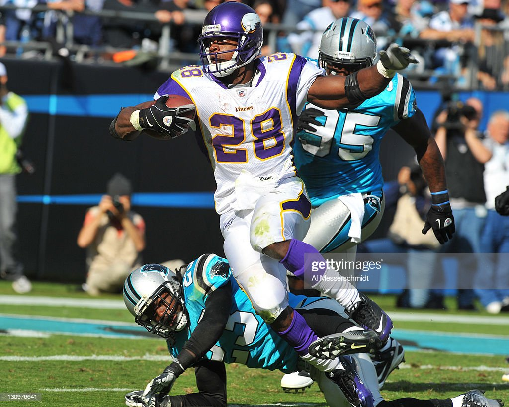 Running back <a gi-track='captionPersonalityLinkClicked' href=/galleries/search?phrase=Adrian+Peterson+-+American+Football+Player+-+Minnesota+Vikings&family=editorial&specificpeople=210807 ng-click='$event.stopPropagation()'>Adrian Peterson</a> #28 of the Minnesota Vikings runs for a nine yard touchdown in the third quarter against the Carolina Panthers October 30, 2011 at Bank of America Stadium in Charlotte, North Carolina. The Vikings won 24 - 21.