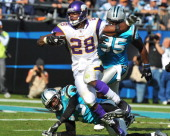 Running back Adrian Peterson of the Minnesota Vikings runs for a nine yard touchdown in the third quarter against the Carolina Panthers October 30...
