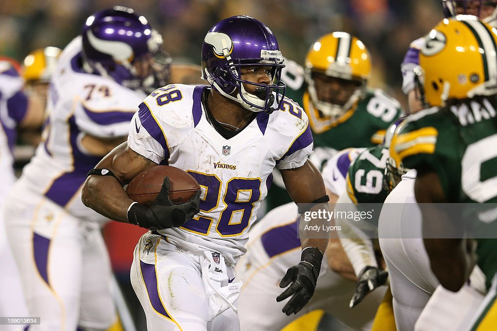 Running back Adrian Peterson #28 of the Minnesota Vikings runs the ball against the Green Bay Packers in the second quarter during the NFC Wild Card Playoff game at Lambeau Field on January 5, 2013 in Green Bay, Wisconsin.