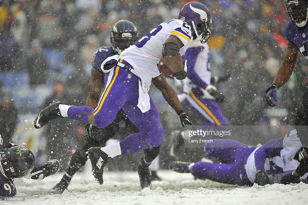 Running back <a gi-track='captionPersonalityLinkClicked' href=/galleries/search?phrase=Adrian+Peterson+-+American+Football+Player+-+Minnesota+Vikings&family=editorial&specificpeople=210807 ng-click='$event.stopPropagation()'>Adrian Peterson</a> #28 of the Minnesota Vikings runs the ball against the Baltimore Ravens at M&T Bank Stadium on December 8, 2013 in Baltimore, Maryland. The Ravens defeated the Vikings 29-26.