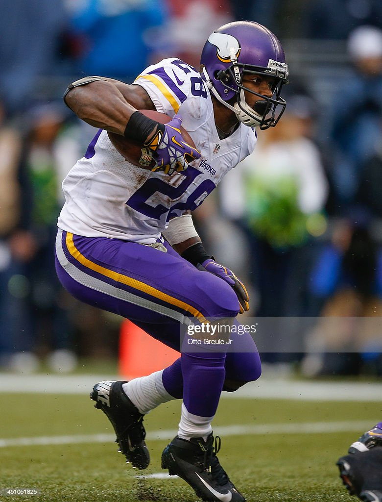 Running back Adrian Peterson #28 of the Minnesota Vikings rushes against the Seattle Seahawks at CenturyLink Field on November 17, 2013 in Seattle, Washington.