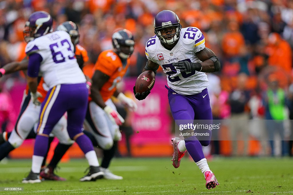 Running back <a gi-track='captionPersonalityLinkClicked' href=/galleries/search?phrase=Adrian+Peterson+-+American+Football+Player+-+Minnesota+Vikings&family=editorial&specificpeople=210807 ng-click='$event.stopPropagation()'>Adrian Peterson</a> #28 of the Minnesota Vikings rushes for a 48 yard touchdown against the Denver Broncos in the fourth quarter of a game at Sports Authority Field at Mile High on October 4, 2015 in Denver, Colorado.