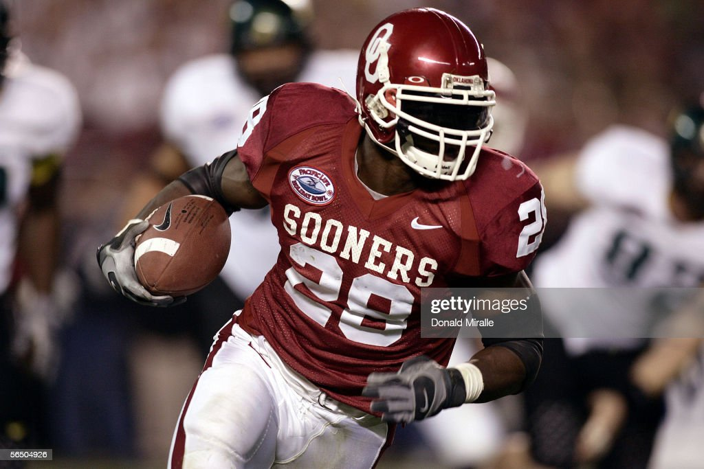 Running back Adrian Peterson of the Oklahoma Sooners runs against the Oregon Ducks during the first half of the Pacific Life Holiday Bowl on December...