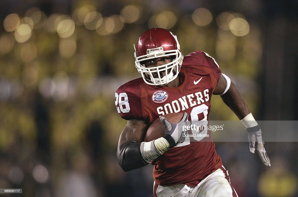 Running back Adrian Peterson of the Oklahoma Sooners runs for a gain against the Oregon Ducks during the Pacific Life Holiday Bowl on December 29...