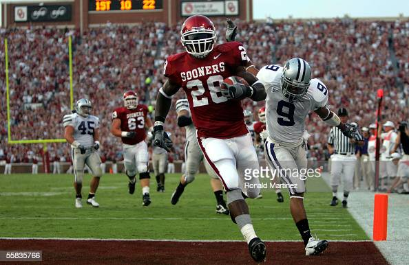 Running back Adrian Peterson of the Oklahoma Sooners runs for a touchdown past Kyle Williams of the Kansas State Wildcats on October 1 2005 at...