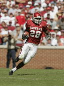 Running back Adrian Peterson of the Oklahoma Sooners runs upfield against the Texas Tech Red Raiders on October 2 2004 at Memorial Stadium in Norman...