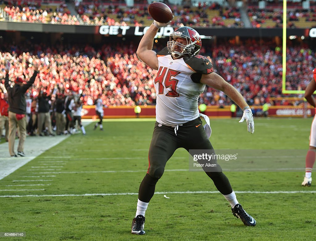 Running back Alan Cross #45 of the Tampa Bay Buccaneers spikes the ball after scoring a touchdown against the Kansas City Chiefs at Arrowhead Stadium during the game on November 20, 2016 in Kansas City, Missouri.