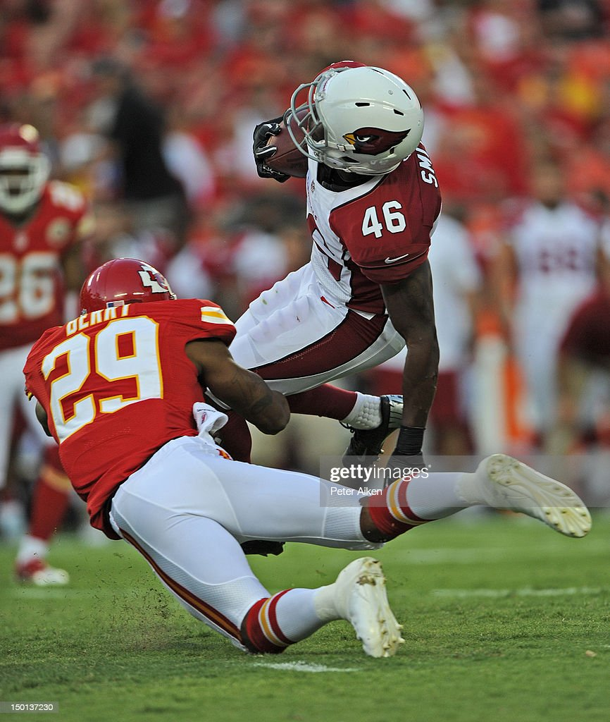 Running back Alfonso Smith #46 of the Arizona Cardinals gets tackled by safety <a gi-track='captionPersonalityLinkClicked' href=/galleries/search?phrase=Eric+Berry+-+American+Football+Player&family=editorial&specificpeople=4501099 ng-click='$event.stopPropagation()'>Eric Berry</a> #29 of the Kansas City Chiefs during the first half on August 10, 2012 at Arrowhead Stadium in Kansas City, Missouri. Kansas City defeated Arizona 27-17.