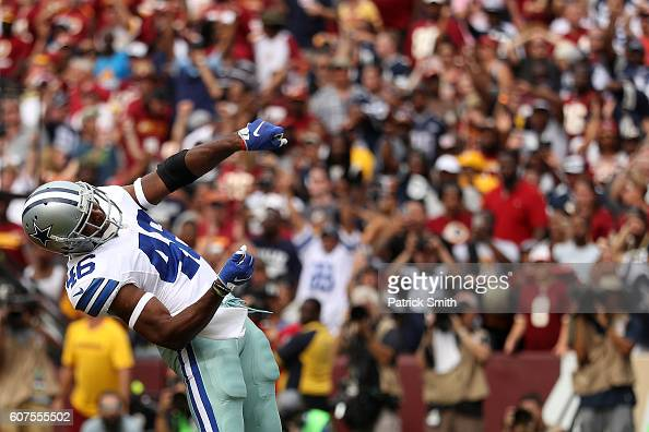Running back Alfred Morris of the Dallas Cowboys celebrates after scoring a fourth quarter touchdown against the Washington Redskins at FedExField on...
