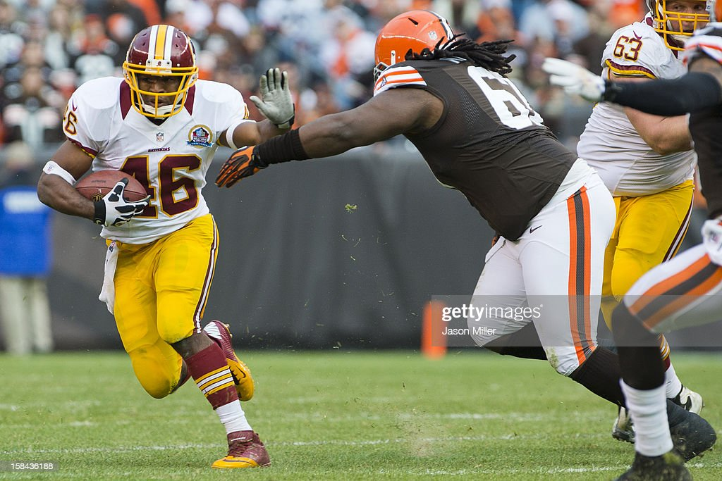 Running back <a gi-track='captionPersonalityLinkClicked' href=/galleries/search?phrase=Alfred+Morris&family=editorial&specificpeople=6350964 ng-click='$event.stopPropagation()'>Alfred Morris</a> #46 of the Washington Redskins avoids a Cleveland Browns defender during the second half at Cleveland Browns Stadium on December 16, 2012 in Cleveland, Ohio. The Redskins defeated the Browns 38-21.