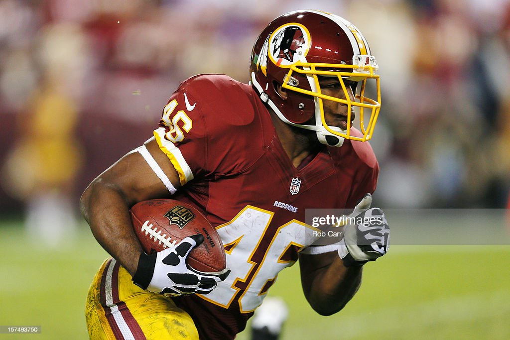 Running back <a gi-track='captionPersonalityLinkClicked' href=/galleries/search?phrase=Alfred+Morris&family=editorial&specificpeople=6350964 ng-click='$event.stopPropagation()'>Alfred Morris</a> #46 of the Washington Redskins carries the ball against the New York Giants during the second half at FedExField on December 3, 2012 in Landover, Maryland.