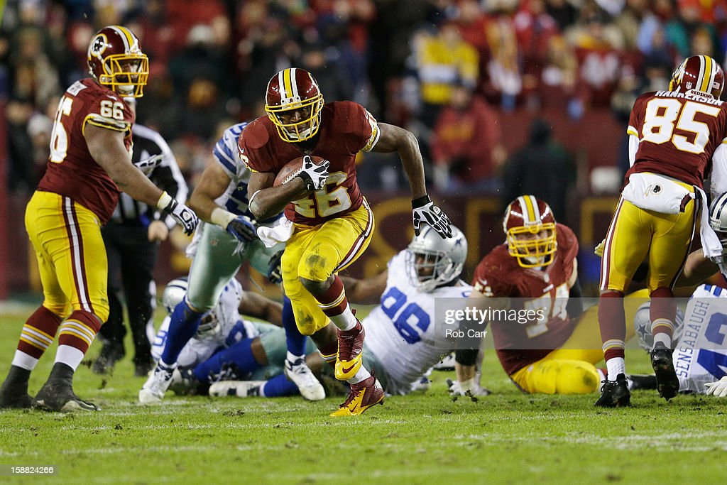 Running back Alfred Morris #46 of the Washington Redskins carries the ball against the Dallas Cowboys during the third quarter at FedExField on December 30, 2012 in Landover, Maryland.