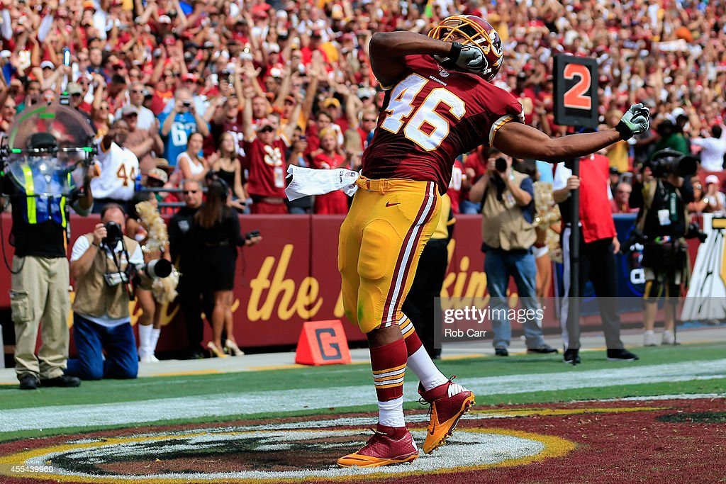 Running back Alfred Morris of the Washington Redskins celebreates after scoring a touchdown during a game against the Jacksonville Jaguars at...