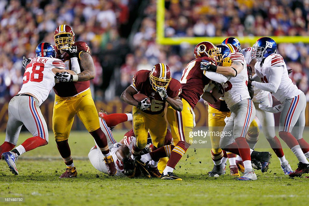 Running back <a gi-track='captionPersonalityLinkClicked' href=/galleries/search?phrase=Alfred+Morris&family=editorial&specificpeople=6350964 ng-click='$event.stopPropagation()'>Alfred Morris</a> #46 of the Washington Redskins rushes for a first down during the closing moments of the Redskins 17-16 win over the New York Giants at FedExField on December 3, 2012 in Landover, Maryland.