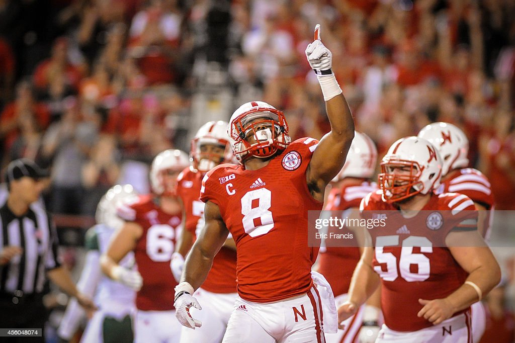 Running back <a gi-track='captionPersonalityLinkClicked' href=/galleries/search?phrase=Ameer+Abdullah&family=editorial&specificpeople=8199967 ng-click='$event.stopPropagation()'>Ameer Abdullah</a> #8 of the Nebraska Cornhuskers reacts after scoring during their game at against the Miami Hurricanes Memorial Stadium on September 20, 2014 in Lincoln, Nebraska. Nebraska defeated Miami 41-31.